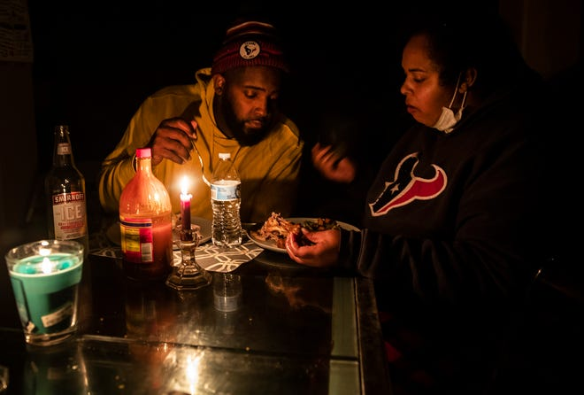 Howard and Nena Mamou eat dinner at their home in Hutto, Texas on Tuesday, Feb 16, 2021. Most homes in the area were without power for nearly 48 hours. Atmos Energy and other power companies were performing rotating outages to protect the electric grid.