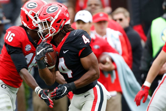 Georgia running back James Cook (4) moves the ball during an NCAA football spring G-Day game in Athens, Ga., Saturday, April 20, 2019. [Photo/Joshua L. Jones, Athens Banner-Herald]