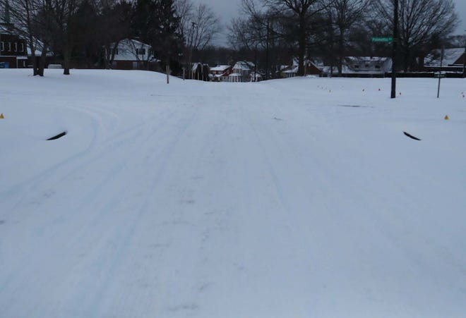 Some Akron residents, such as those living on Girard Street and Palmetto Avenue were still awaiting a truck to plow their street on Tuesday evening.