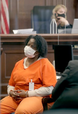 Hedy Moss listens to impact statements before being sentenced to 21 years to life in prison for the shooting death of Ernest Sherman on Wednesday in Summit County Judge Kelly McLaughlin's Akron courtroom.