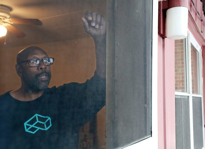Mark Amos, 63, talks about losing his job and how he came to live in his apartment in Highland Square in Akron.