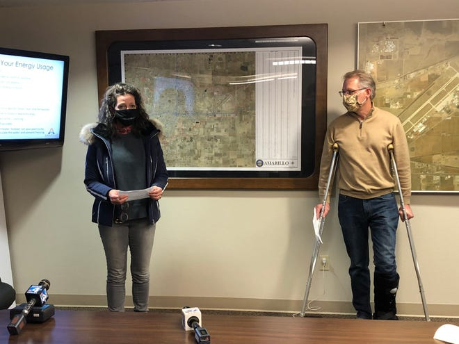 City of Amarillo Mayor Ginger Nelson (left) and city of Canyon Mayor Gary Hinders speak during a Tuesday evening news conference, urging individuals in the community to conserve their energy usage over the next few days as the inclement winter weather continues in the community.