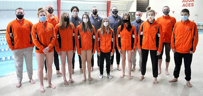Ashland's district swimming qualifiers (back row from the left) Triton Schuster, Noah Danison, Daniel Cho, Rylan McDaniel, Seth Will, Bailey Parsons, Lukah Will and Grant Wallery, (front row from the left) Camden McDaniel, Sara Fink, Jenna Hartson, Mackie Parsons, Nykole Doerner and Amber Harry pose for a picture on Wednesday.