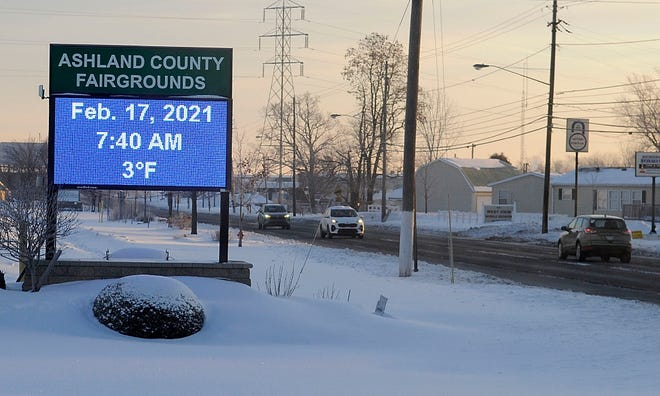 The time/temperature sign at the Ashland County Fairgrounds reads 3 degrees fahrenheit Wednesday morning, Feb. 17, 2021 . Temperatures today will be on the cold side with high of 20 degrees. TOM E. PUSKAR/TIMES-GAZETTE.COM