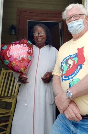 Harvey Stoneburner delivers a Valentine balloon to Irestine Bouie