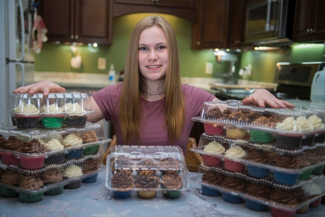 Britt Joiner, 14, makes cupcakes to sell then donates the proceeds to charity through her business, Britt's Bakery.