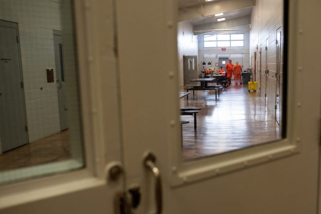 In this file photo, inmates gather in a common area outside of their cells at Joseph Harp Correctional Center in Lexington. Whitney Bryen/Oklahoma Watch