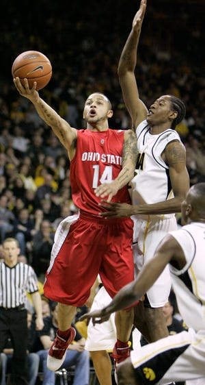 Ohio State's Jamar Butler, left, drives to the basket past Iowa's Kurt Looby during the first half of a basketball game, Saturday, Feb. 2, 2008, in Iowa City, Iowa.  (AP Photo/Charlie Neibergall)