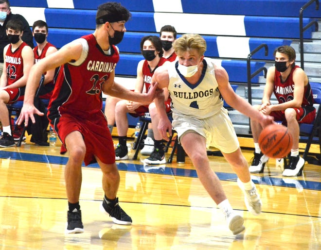 Inland Lakes senior guard Beau Vizina (4) looks to get past Johannesburg-Lewiston's Jason Richter (left) during a varsity boys basketball matchup in Indian River on Tuesday.
