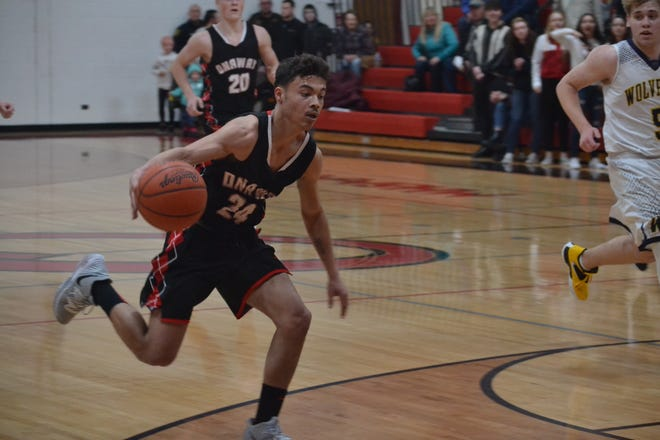 Senior guard Kevin Pearson (24) scored 13 points for the Onaway boys basketball team, which picked up its first victory of the season with a 63-33 rout at Bellaire on Tuesday.