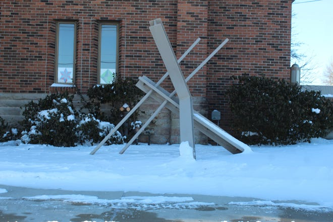 The steel beams sculpture in front of the Cheboygan Opera House will soon be replaced with a local artist's vision on what goes on inside the Cheboygan Opera House.