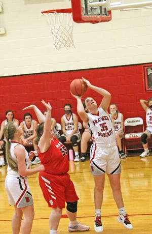 Braymer forward Kennedy Stone has an unfettered, point-blank shot which she converted for a third-quarter bucket during the Lady 'Cats' 49-33 triumph over Brunswick in the CLAA high school basketball tournament at Hale School this past Tuesday. It was the Braymer girls' first-ever game in the tournament after BHS joined the conference this school year.