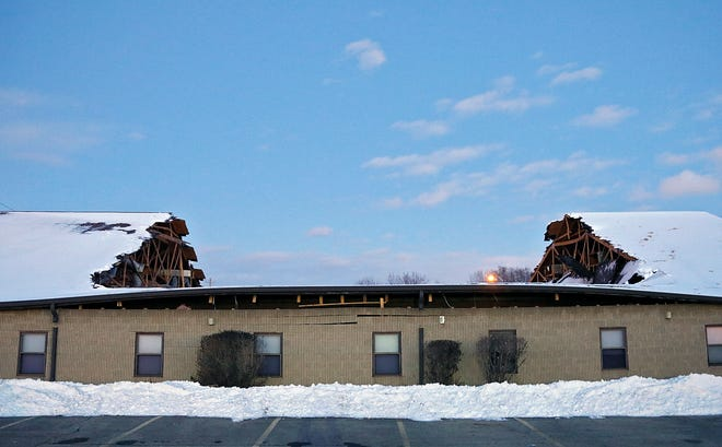 The roof of a secondary building at Living Faith Apostolic Church collapsed early Tuesday morning following heavy snowfalls in Columbus, Ohio on February 16, 2021.