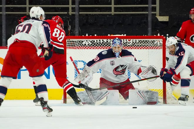 Blue Jackets goalie Elvis Merzlikins allowed two goals on nine shots in a relief appearance Monday in a loss to Carolina.