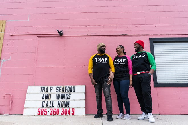 Co-owners Chad Smith, Jerne' Martin and Divine Martin stand outside of Trap Seafood & Wings. They are open Tuesday through Saturday at 9187 E Main St in Houma.