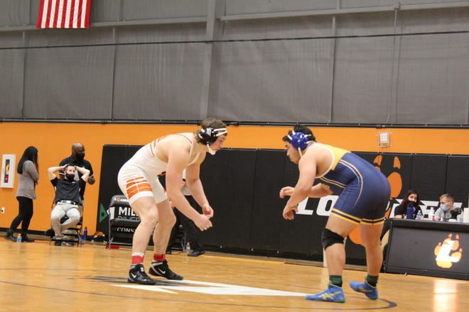 Siena Heights freshman Christian DeLuna wrestles against Lourdes University's Alec Moore-Nash during the 2021 Wolverine-Hoosier Athletic Conference championships on Saturday. (Photo courtesy Lourdes Athletics)