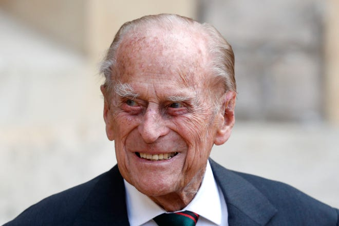 In this Wednesday July 22, 2020 file photo, Britain's Prince Philip arrives for a ceremony for the transfer of the Colonel-in-Chief of the Rifles from himself to Camilla, Duchess of Cornwall, at Windsor Castle, England. Buckingham Palace says 99-year-old Prince Philip has been admitted to a London hospital after feeling unwell. The palace says the husband of Queen Elizabeth II was admitted to the King Edward VII Hospital on the evening of Tuesday Feb. 16, 2021.