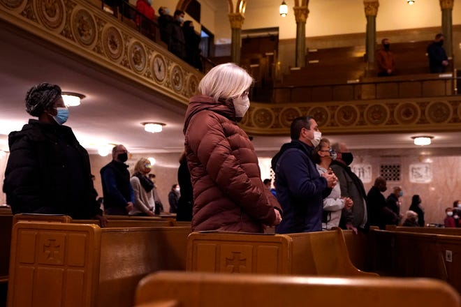 Parishioners pray during Ash Wednesday service at the St. Aloysius Catholic Church, Wednesday, Feb. 17, 2021, in Detroit. The ashes, a symbol of penance, made from palm leaves used in last year's Palm Sunday liturgy were sprinkled on the forehead which is a departure from the usual practice of making the sign of the cross on the forehead. The sprinkling, because of the pandemic, is a departure from the usual practice of making the sign of the cross on the forehead and follows an ancient method still common in parts of the world today.