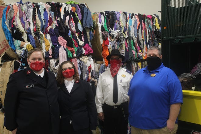 The Salvation Army in Adrian showed off a new addition to its thrift store Wednesday morning. The space will be used for storing donations. Pictured from left are Capts. Jacob and Melinda Tripp, store consultant Tim Schroeder and store manager Ron Robinson.