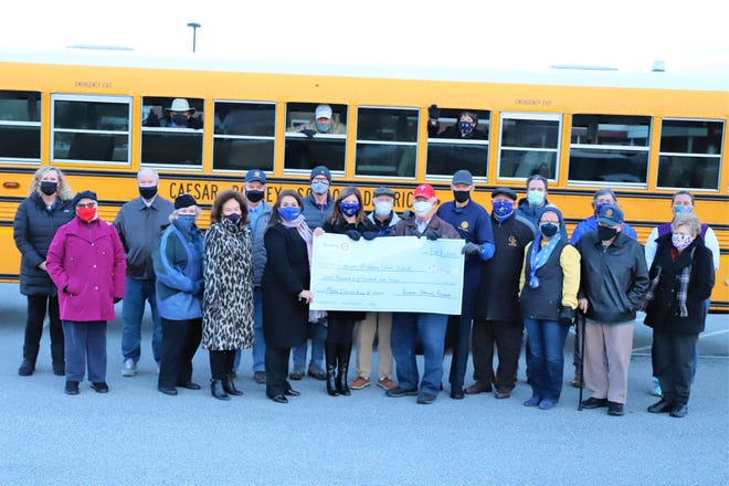 Members of the Camden-Wyoming Rotary Club present a check for $7,800 to staff of the Caesar Rodney School District to support the effort to convert five school buses in to mobile Wi-Fi hot spots. The buses will be used across the District to aid communities that have difficulty securing or maintaining an internet connection. Rotary members in attendance included President Jazzy Johnson, Vice President Elestine Cooper, Past President Debbie Taylor, Secretary Steve Welde, Treasurer Dave Walczak and members Trish Rodriguez, Marylyn Schaeffler, Nick Alvarez, Leo Schaeffler, John Kirby, Cliff Hutton, Ray Dawson, José Echeverri, Ted Tull, Ray Dawson and Chuck Gruwell. Caesar Rodney School District staff include Postlethwait Middle School Principal Kristina Failing, Director of Curriculum and Instruction Tara Faircloth, Superintendent Kevin Fitzgerald, Technology Coordinator Susan Shelor, Network Control Specialist Jesse Shrader, School Board President Mike Marasco and School Board Vice President Jessica Marelli.
