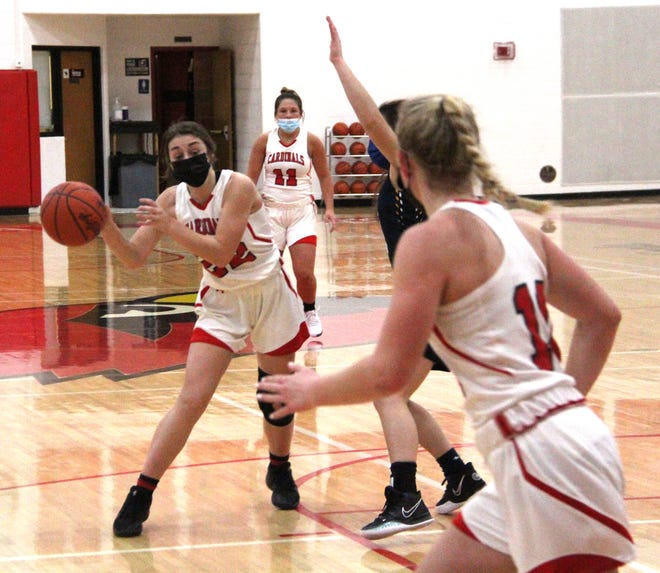 Coldwater's Jayla Foster (22) looks for an open teammate in early season basketball action.