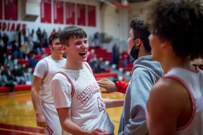 Braden Pottberg (4) celebrates with his Fort Osage teammates after sinking a game-winning layup at the buzzer in a 53-51 win over rival William Chrisman Tuesday.