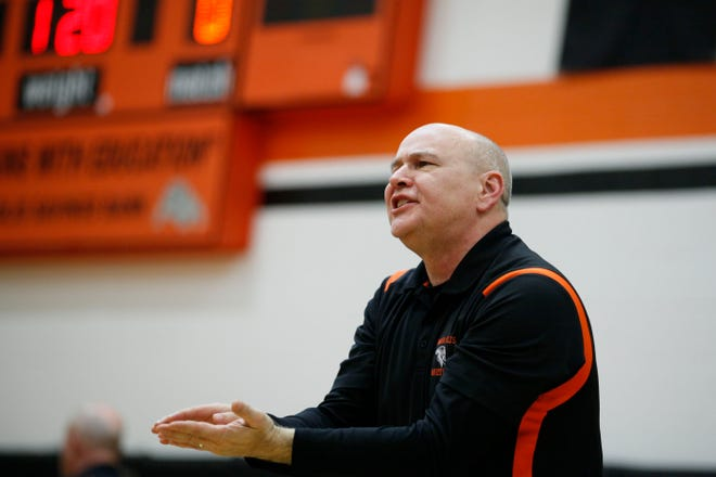 Mark Swafford, assistant wrestling coach fro Mediapolis watches the varsity dual against Davenport Assumption Thursday, Dec. 3, 2015 at Mediapolis High School.