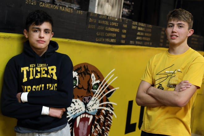 New London High School wrestlers Marcel Lopez and his brother Dominic, Monday Feb. 15, 2021 in the school's wrestling training room. The brothers along with several of their teammates will be returning to Des Moines for the state's wrestling tournament at the Wells Fargo Arena Thursday through Saturday.