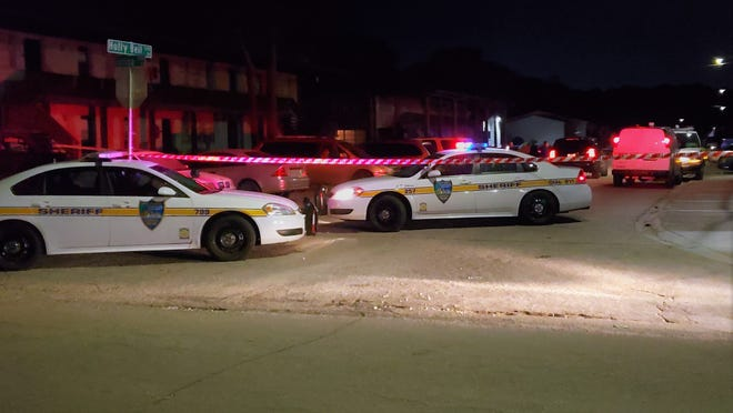 Police investigate a deadly shooting at a Holly Bell Drive apartment Tuesday.