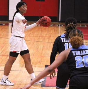Bishop Kenny forward Jasmyne Roberts (24) directs the offense in Tuesday night's girls basketball regional semifinal against Ribault.