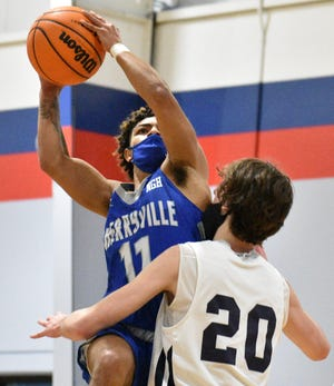 Cherryville's Lavonte Hughes goes up strong against Lincoln Charter during Tuesday's game in Denver. [JOE L. HUGHES II/Gaston Gazette]