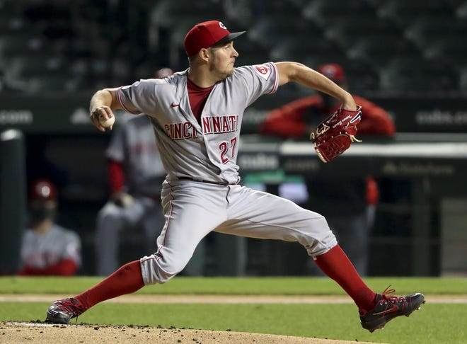 Cincinnati Reds starting pitcher Trevor Bauer pitches during the first inning against the Chicago Cubs at Wrigley Field Wednesday Sept. 9, 2020 in Chicago.