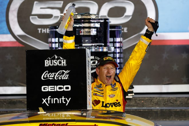 Michael McDowell, driver of the (34) Love's Travel Stops Ford, celebrates in victory lane after winning the NASCAR Cup Series 63rd Annual Daytona 500 at Daytona International Speedway on Feb. 14, 2021 in Daytona Beach, Fla.