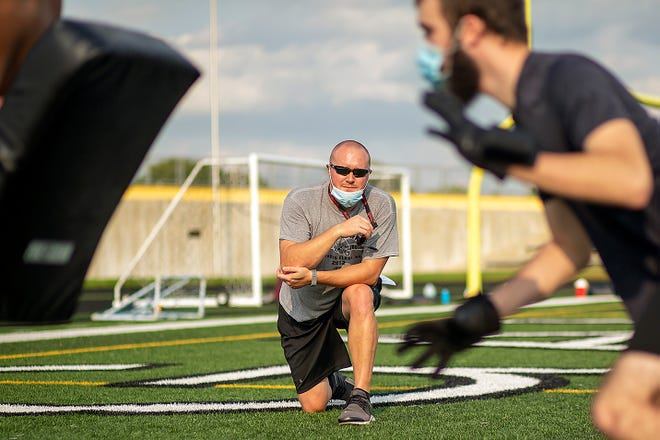 Galesburg High School football coach Mike Washabaugh watches a defensive drill during a workout on Wednesday, Sept. 16, 2020 at Van Dyke Field.