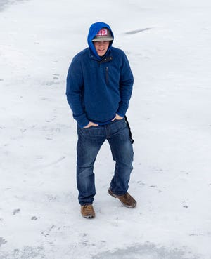Aaron Mills, 16, a student at Glen Rose High School, walks on the frozen Paluxy River near The Riverwalk on Tuesday morning. Temps in the area were at minus-2. The forecast for the weekend is for temps to reach the 50s.