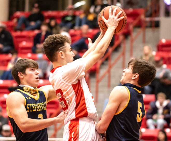Glen Rose's Caden Schinagel rips down a rebound in front of a pair of Stephenville defenders on Friday night.