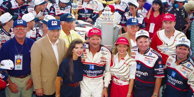 Dale Earnhardt, center, poses with his wife, Teresa, left, and also members of his racing team, including crew chief Andy Petree, far right, after winning a race in 1994 at Indianapolis Motor Speedway.