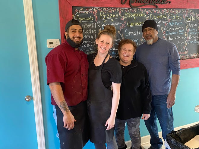 Kristopher Castillo, Kristen Reilly, Miriam and James Castillo are the owners and staff at K's NY Pizza and SoFlo Food, which opened Feb. 14 on Upward Road.