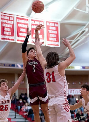 Buhler's Max Alexander (1) shoots past McPherson's Mason Miller (31) during their game in McPherson on Tuesday evening. McPherson defeated Buhler 51-50.