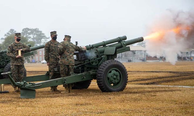 Marines from Fox Battery, 2nd Battalion, 10th Marine Regiment, 2d Marine Division aboard Camp Lejeune fired their guns in observance of President's Day. During the salute, the guns are discharged at five-second intervals 21 times. Gun salutes are also held on Memorial Day and Independence Day each year.
