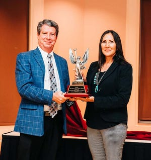 April Clark was named the 2020 Woman of the Year, Michael Hoopes of Marine Chevrolet Cadillac presented her award during the Jacksonville-Onslow Chamber of Commerce's Membership Meeting.