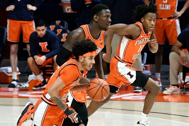 Illinois, led by Ayo Dosunmu (right), Kofi Cockburn (center) and Andre Curbelo (left), is among the favorites to cut the nets down in Indianapolis.