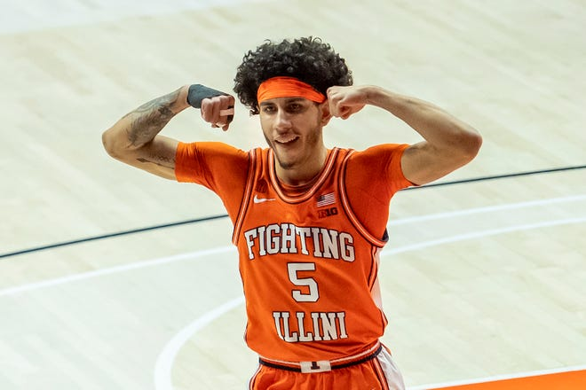 Feb 16, 2021; Champaign, Illinois, USA; Illinois Fighting Illini guard Andre Curbelo (5) celebrates after his team scores against the Northwestern Wildcats during the first half at the State Farm Center.