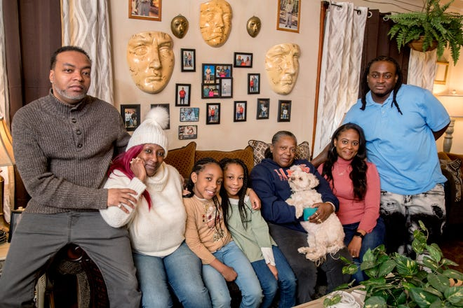 Friends and family of Cherish Coleman, from left to right, Curtis Price, his fiancee and her mother Kimberly Coleman, daughters Liberty Coleman, 9, and Kymbre, 8, grandmother Armanda Coleman, half-sister Mykisha Griffin and brother Larenzo Coleman gather Wednesday, Feb. 17, 2021 in the living room of Armanda Coleman's South Side home to remember Cherish, who died Friday night in a car crash on Western Avenue.