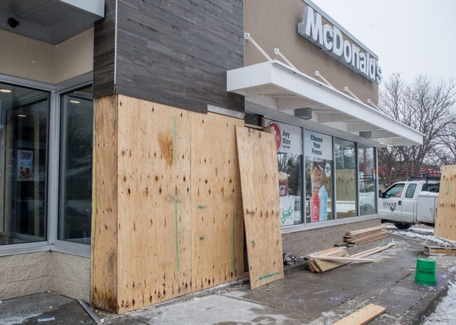Workers have begun boarding up a section of McDonald's, 627 N. Western Ave., on Wednesday, Feb. 17, 2021 that was struck by a Peoria Police squad car earlier that morning.