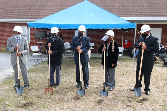 St. John FWB Church Chairperson James Fonville, Kinston Mayor Dontario Hardy, St. John Bishop J.E. Reddick, St. John Chairperson Virginia Cox-Daughtery, and St. John Pastor William F. Hudson, Jr. break ground Wednesday, Feb. 17, at the church to kick off the construction of their new church building at the same location, 405 E. Blount St. in Kinston.