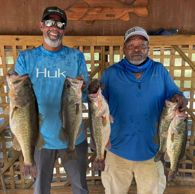 John Myers, left and Reggie Bush had 22.13 pounds and an 8.68-pound big bass to win the Xtreme Bass Series Kissimmee Division tournament Feb. 14 on Lake Kissimmee.