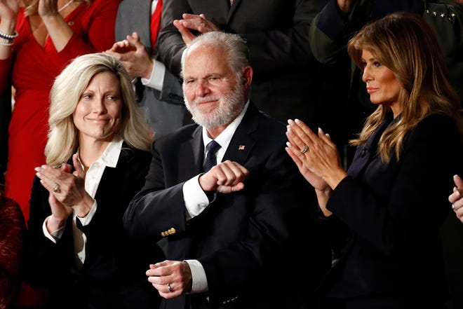 Rush Limbaugh reacts as then first Lady Melania Trump, and his wife Kathryn, applaud, as then President Donald Trump delivers his State of the Union address to a joint session of Congress in 2020. Limbaugh, the talk radio host who became the voice of American conservatism, died  Wednesday at 70. (AP Photo/Patrick Semansky, File)