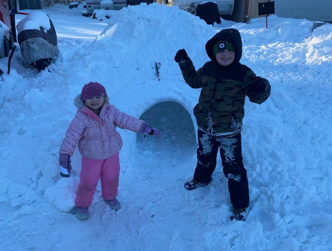 Terry, 7, and Elliana Pierce, 2, celebrate their igloo.