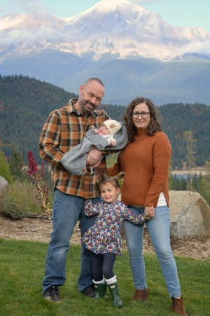 Dr. Lindsay Fox with her husband, Ian, and their two daughters, 3-year-old Alaris and 6-month-old Bridie.